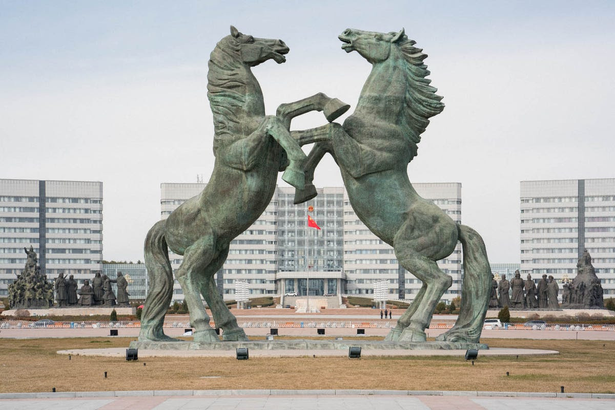 Two horse statues preside over Genghis Khan Plaza at the town's center. Horses are the city's adopted symbol, and they represent a nomadic culture.