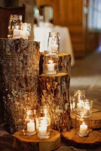 mason jar candles on tree stumps