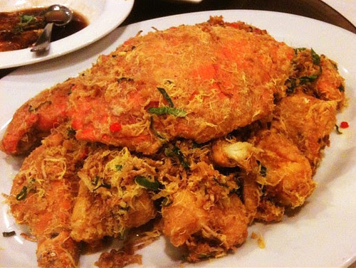 Salted egg yolk crab with lots of pine nuts, curry leaves, crispy yam strips (hand-shredded), and hae bee (dried shrimp). Instagram photo