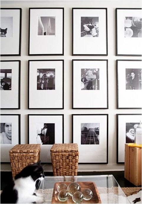 Key to Great Black and White Gallery: symmetrical grid, oversized frames, off centered mats.
