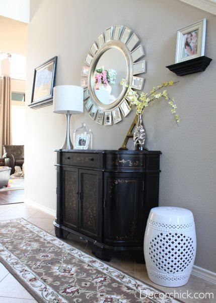 Pretty Entryway with Z-Gallerie Knock Off Devon Mirror. I dont like the table but the mirror and details are nice.