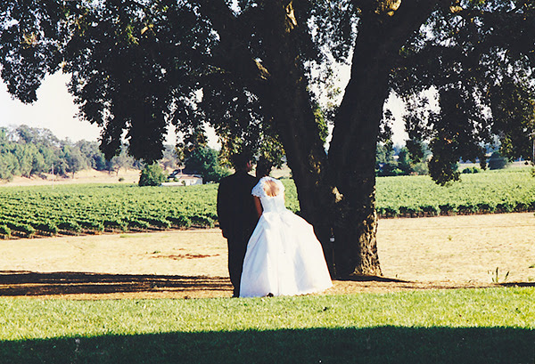 {This is my favorite wedding photo and was captured by a guest using one of the disposable cameras we provided.  My husband and I were married under this tree.}