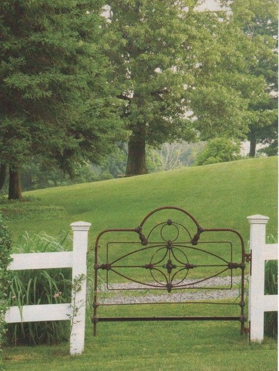 old iron bed frame used as a gate!