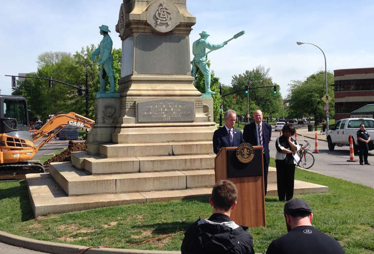 Louisville Mayor Greg Fischer speaks in front of the Confederate monument near the University of Louisville with university President James Ramsey, left, in Louisville, Ky., Friday, April 29, 2016. The Confederate monument capped with a statue of Jefferson Davis will be removed from a spot near the University of Louisville campus where it has stood since 1895.
