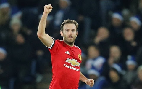 Juan Mata celebrates his first-half equaliser
