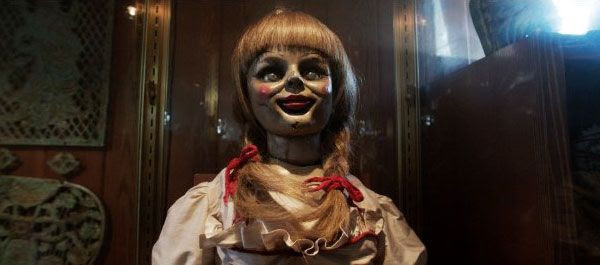 Annabelle the Doll sits locked up inside a glass case at the Warren household in THE CONJURING.