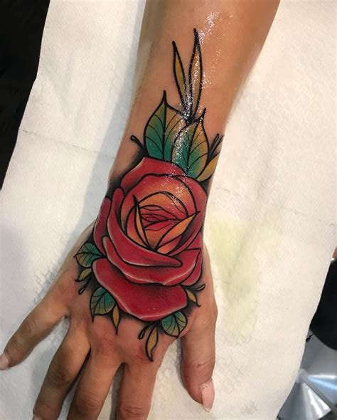 pin maita evita tatoo rose hand tattoo red rose