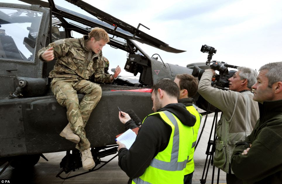 Prince Harry chats to reporters and a TV crew following the checks on his aircraft
