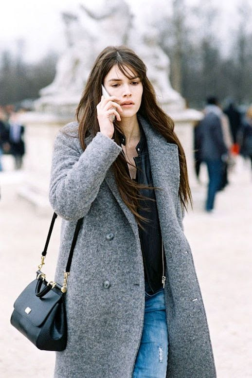Le Fashion Blog Model Off Duty Street Style Paris Fashion Week Vanessa Moody Longline Wool Blend Coat Light Wash Distressed Jeans Via Vanessa Jackman