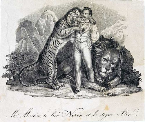 lion tamer with tiger and lion