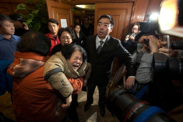 A relative of Chinese passengers aboard Malaysia Airlines MH370 grieves after being told of the latest news in Beijing, China, Monday, March 24, 2014.