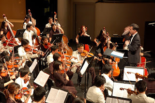 Taken during one of NUS Symphony Orchestra's concerts. Photo credit: Jay.