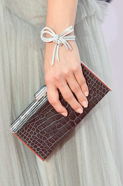 Actress Emily VanCamp (handbag & jewelry detail) arrives at the 64th Annual Primetime Emmy Awards at Nokia Theatre L.A. Live on September 23, 2012 in Los Angeles, California.