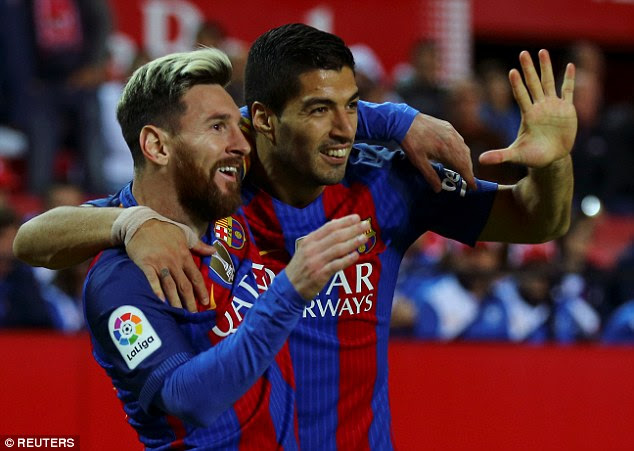 Lionel Messi and Luis Suarez enjoy celebrating the turnaround against Sevilla on Sunday