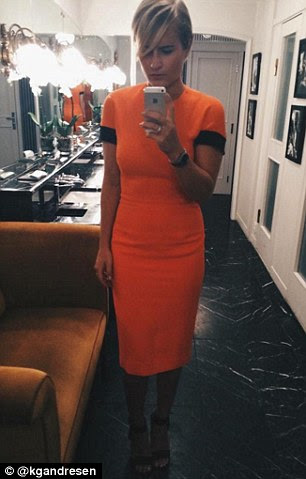 The 20-year-old is pictured in a Victoria Beckham dress