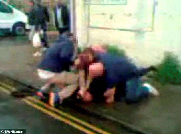 Shocking footage has emerged of a man being pinned to the floor by undercover police officers in Bedford