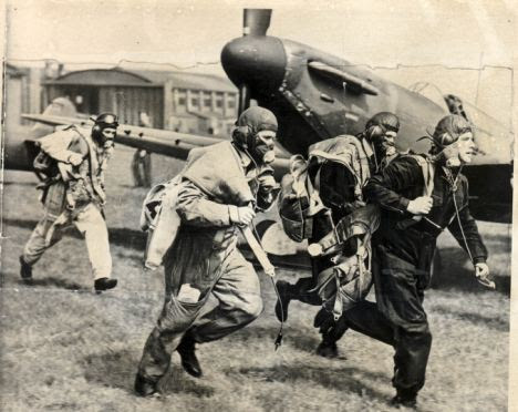 Ready for action: RAF fighter pilots respond to the scramble