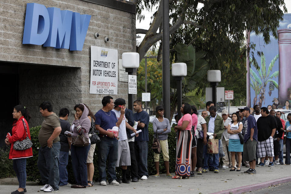 Fewer people are applying for a driver's license, according to a new study released this week. Above, a 2011 queue for a motor vehicle licenses outside a DMV office in Los Angeles.