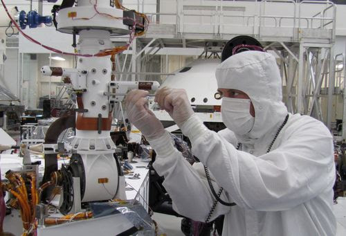 Sensors on two finger-like mini-booms extending horizontally from the mast of NASA's Mars rover Curiosity will monitor wind speed, wind direction and air temperature.