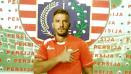 Indosport - Ilustrasi Marko Simic resmi mengenakan jersey Persija Jakarta.
