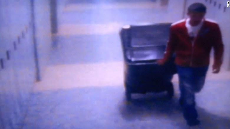 Prosecutors released surveillance photos in Philip Chism's murder trial Monday, showing him wheeling a recycling bin to allegedly  dispose of his slain algebra teacher.