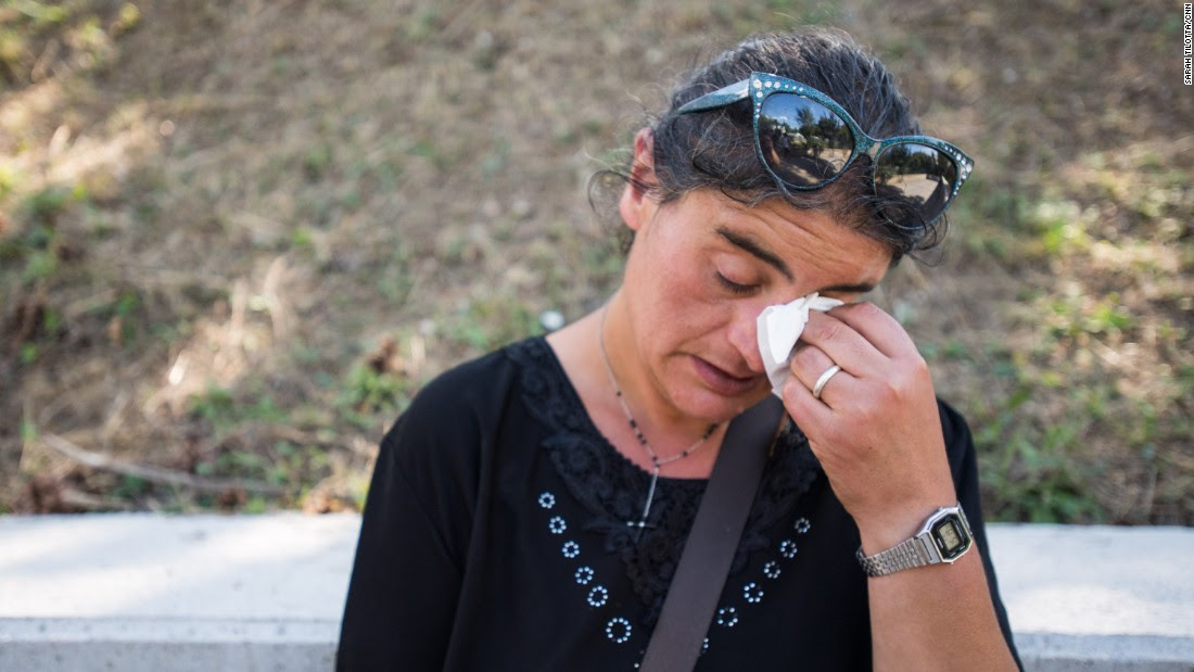 Cecilia d'Alessio takes a moment to grieve for three family members who died in the earthquake in Amatrice. She owns a home in Amatrice city center which she says has now been destroyed.