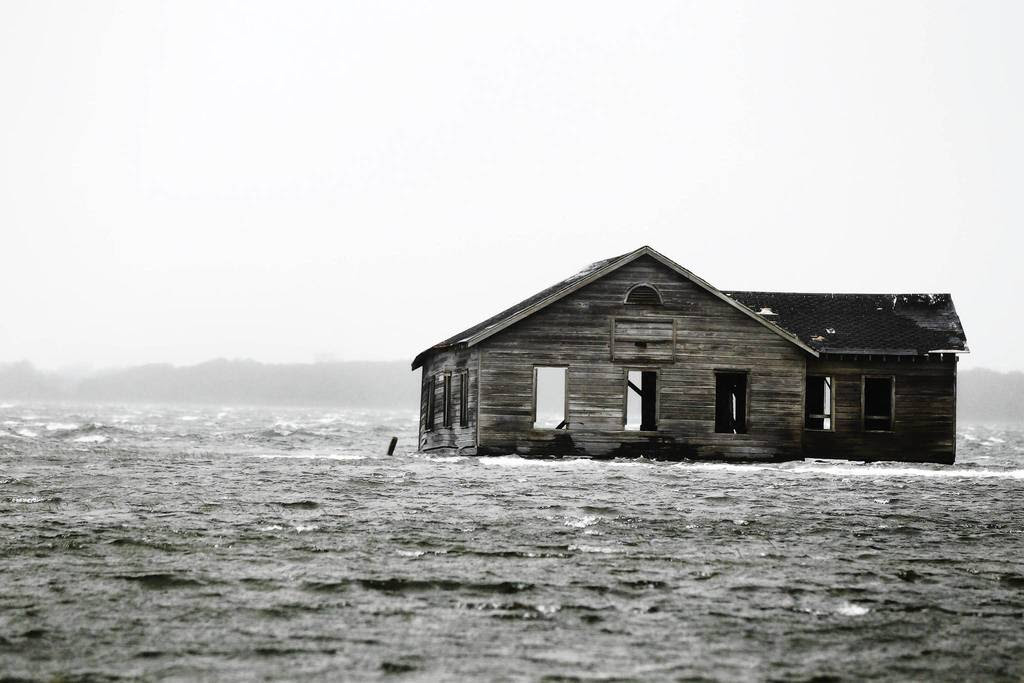 An abandoned home is inundated with water at Shinnecock Bay in Southampton, New York. Hurricane Sandy, the monster storm bearing down on the East Coast, strengthened on Monday after hundreds of thousands moved to higher ground, public transport shut down and the stock market suffered its first weather-related closure in 27 years.