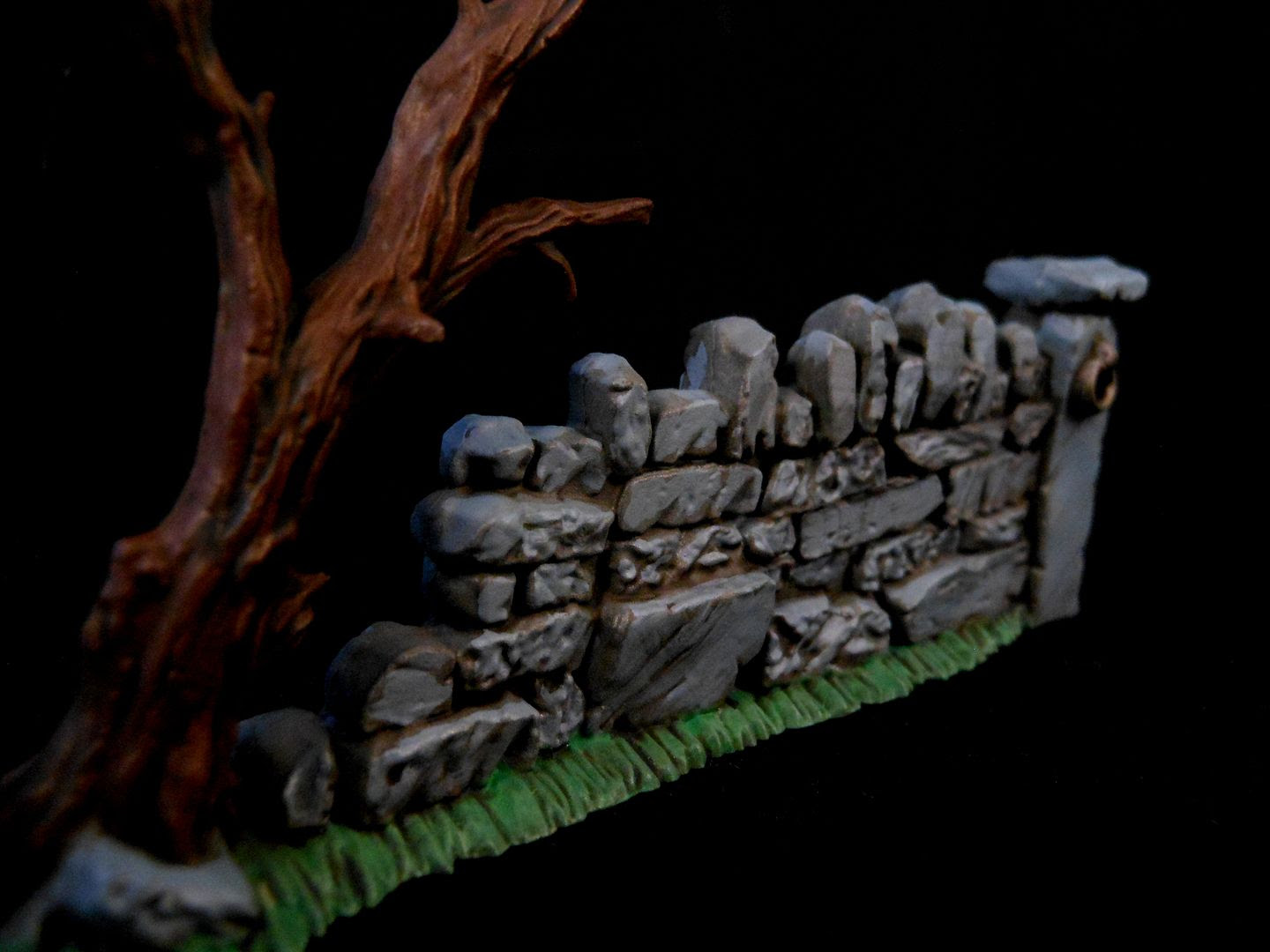 A close-up view of a Games Workshop wall, painted with washes to bring out the amazing details.