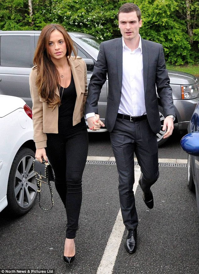 Premier League star Adam Johnson appeared hand-in-hand with his girlfriend Stacey Flounders as he arrived at Peterlee Magistrates' Court, County Durham, to face child sex charges