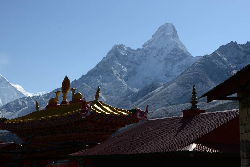 Tengboche Buddhist monastery gate and Mount Ama Dablam, with its 6,812 metre peak, is seen from Tengboche some 300kms north-east of Kathmandu on May 5, 2017. / AFP PHOTO / PRAKASH MATHEMA        (Photo credit should read PRAKASH MATHEMA/AFP/Getty Images)