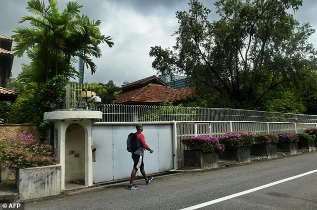 A man walks past the house of Singapore's late founding father Lee Kuan Yew at Oxley Rise in Singapore