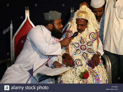 Maulvi or Imam conducts Islamic wedding ceremony or Nikkah