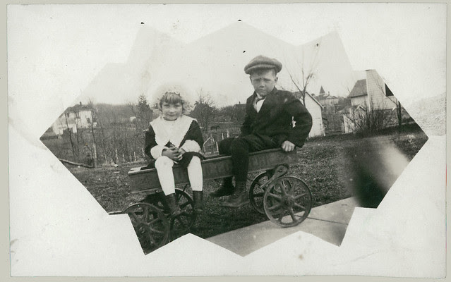 Two children in a wagon