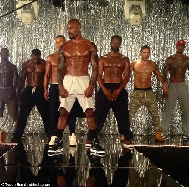 Oiled up: In another sneak peek, the actor can be seen leading his co-stars as they start a routine