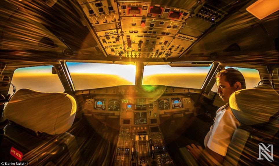 Into the light: He says he began the  project in a bid to document his daily routine through a series of stunning photographs that reveal exactly what it is like for pilots at 35,000 feet