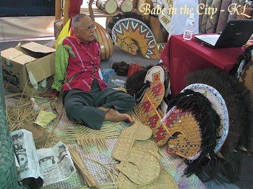 PakCik taking a rest from making Kuda Kepang