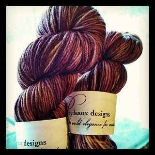 Losing the natural light fast, but tried to get a better shot of the @phydeauxdesigns #Caresse #yarn from my #yarnbox to show the gorgeous color! #knitting #knitstagram #stashenhancement