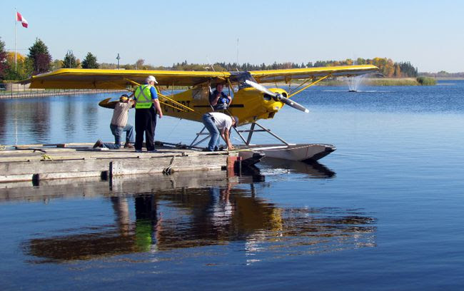 BRAD RATCLIFF/For The Daily Press A float plane docks on Porcupine Lake during the recent Young Eagles program. This is the second year that a float plane fly has been added to the Young Eagles program in the fall, which uses land-based planes in early summer.