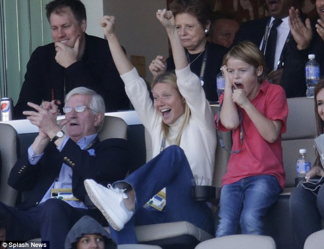 Jumping for joy: The cute duo, who were also joined by Gwyneth's son Moses, cheered Chris Martin and Beyonce during the showstopping half-time performance