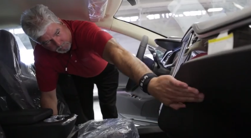 Of course, robots can't do everything. In this photo, a design engineer inspects a new Model S before it is sent out.