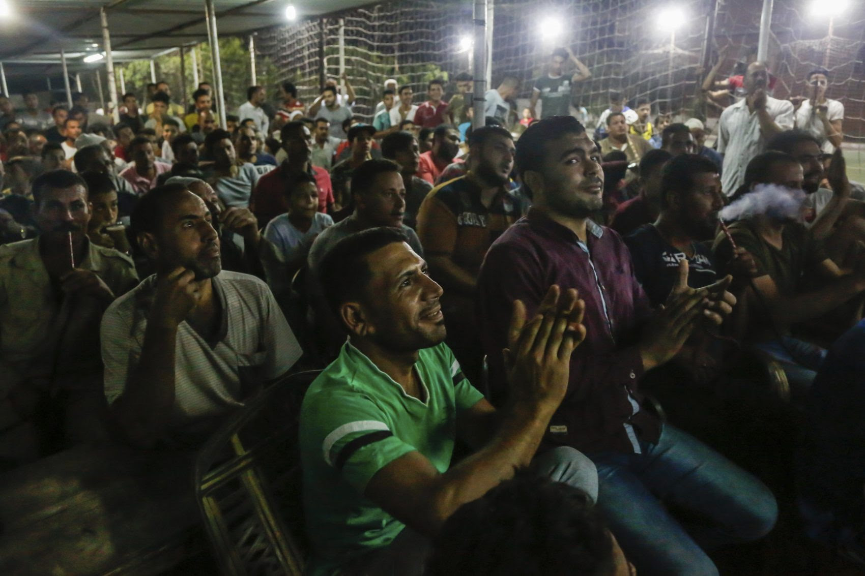 Egyptian fans watch the Egypt-Russia World Cup game in the hometown of Mohammed Salah. (Islam Safwat/AP)