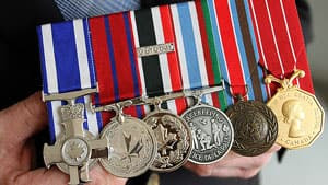 Ret. Sgt. Tom Hoppe shows off his medals, including the Meritorious Service Cross and the Medal of Bravery, at his Kingston, Ont. home.