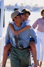 Photograph of a father giving his son a piggyback ride