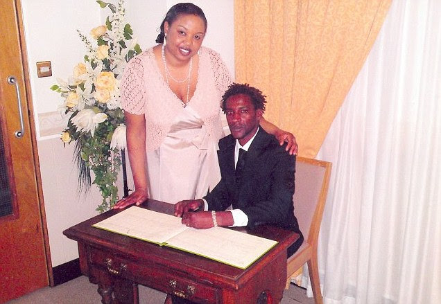 Zambian woman Leya Mtonga, 39 signing the marriage register with Portuguese national, Nuno Moriera, 29