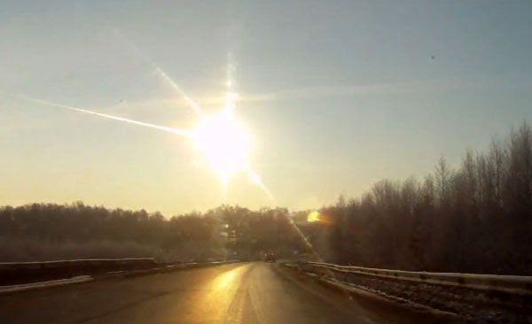 A meteor—believed to be a small asteroid by NASA—enters the atmosphere and explodes above Chelyabinsk, Russia, on February 15, 2013.