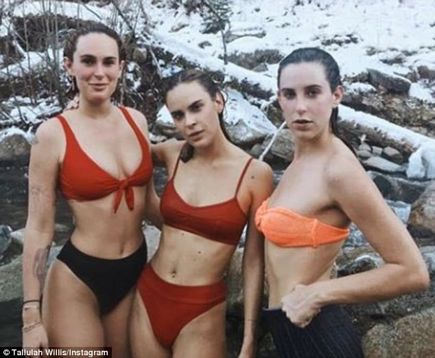 Cold: Rumer, Scout and Tallulah all stropped down to their bikinis for a striking image by a river