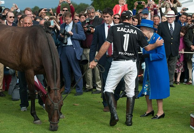 The polo player also placed a hand on the Queen's shoulder before the pair posed for photographs