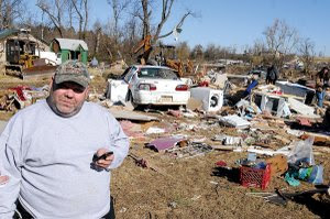 Richard Grubbs looks through debris Saturday surrounding the house he and his mother, Ruth Mauch, were living in when it was destroyed by the tornado that ripped through the Cincinnati community Friday morning. Grubbs' grandmother Mamie Wilson and husband Buck Wilson were killed by the storm.