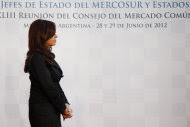 Argentina's President Cristina Fernandez waits for the arrivals of Uruguay's President Jose Mujica and Brazil's President Dilma Rousseff for a photo opportunity, at the Mercosur summit in Mendoza, Argentina, Friday, June 29, 2012. Leaders of the four-nation are discussing the idea of sanctioning Paraguay's new government for ousting its president in a quick impeachment trial last week. (AP Photo/Natacha Pisarenko)