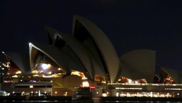 The Sydney Opera House can be seen after its lights were switched off for Earth Hour in Sydney, Australia, March 19, 2016.